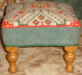 Customers completed tapestry attached to footstool
